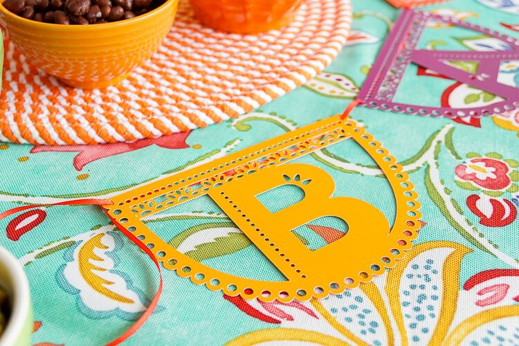 These fun papel picado letters help you create a garland t0 add a festive look to your outdoor party, fiesta, or Cinco de Mayo gathering!