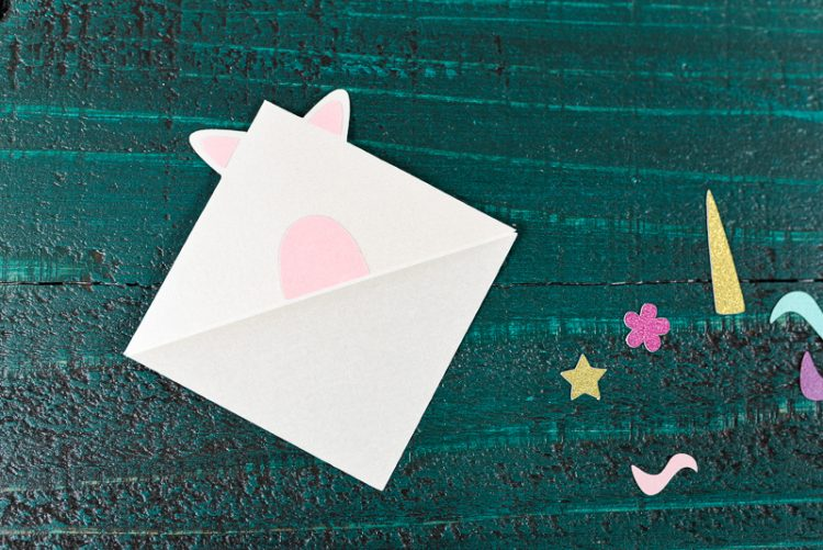 Glue the unicorn's nose - Make these adorable little unicorn bookmarks! The perfect craft for any time you're diving into a particularly whimsical book. A FREE SVG and DXF download.