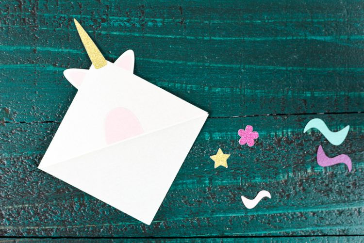 Glue the unicorn's horn - Make these adorable little unicorn bookmarks! The perfect craft for any time you're diving into a particularly whimsical book. A FREE SVG and DXF download.