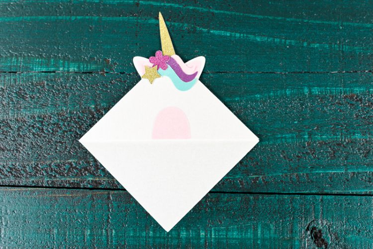 Glue the unicorn's star and flower - Make these adorable little unicorn bookmarks! The perfect craft for any time you're diving into a particularly whimsical book. A FREE SVG and DXF download.