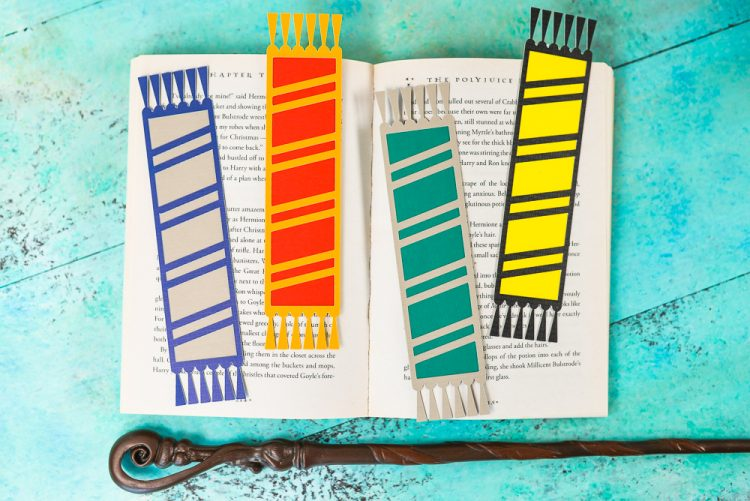 Declare your Hogwarts House with these fun cut paper bookmarks designed to look like Harry Potter and his friends' (and enemies'!) scarves! Free SVG download for the Cricut or Silhouette.