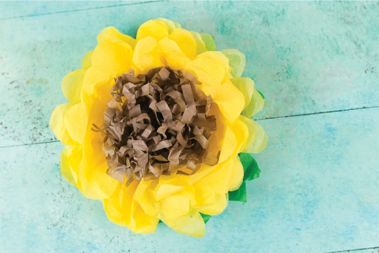 Celebrate summer with these bright and happy tissue paper sunflowers! See how to make them and learn how to upload your own projects to the new JOANN app! #ad #handmadewithjoann