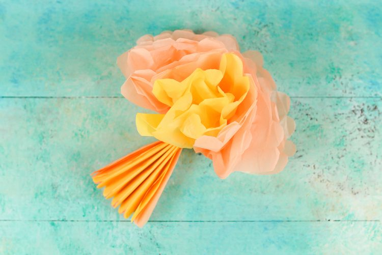 Delicate tissue paper is the perfect material for making paper flowers! These tissue paper peonies are a beautiful way to decorate a party, shower, or even nursery.
