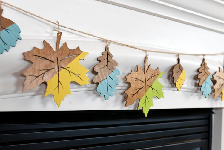 Not a fan of traditional fall colors? No worries! These whimsical fall mantel ideas pull from a less-traditional palette of yellow, teal, and green. Combine these colors with woodland elements and you have perfectly eclectic fall decor!
