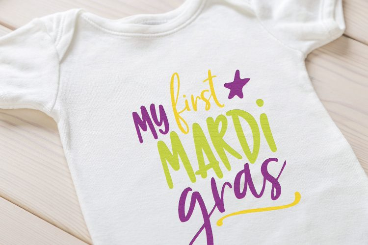 "Cute ""My First Mardi Gras"" Onesie. Grab your beads and your king cake -- it's time for Mardi Gras! Use these Mardi Gras SVG files to make cute shirts, tumblers, and tote bags to celebrate Fat Tuesday!"