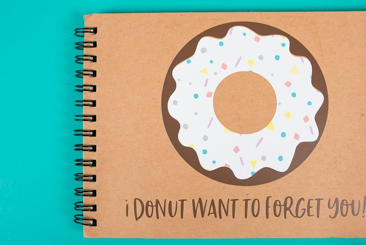 "Your kiddos can collect all their friends', teachers' and classmates' autographs—as well as make them laugh!—in this personalized school autograph book that reads ""I donut want to forget you"" on the cover!"
