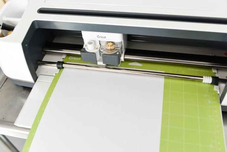 Mat inside the machine with white paper | There's so much to create using the Cricut Knife Blade. Here are 10 of my best Knife Blade tips to get it just right every time! You'll learn how to prep your mat, what to look for in Design Space, and other tricks for making the most of your Cricut Knife Blade.