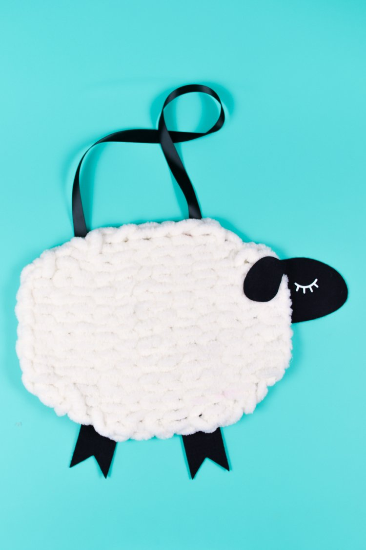 Have you tried loop yarn? Use this super-soft Bernat Alize Blanket-EZ yarn to knit without needles! Use it to create this adorable nursery decor: a yarn and felt sheep wall hanging!