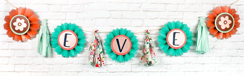 Create this cute baby shower banner using a range of different supplies and your Cricut Explore or Maker!