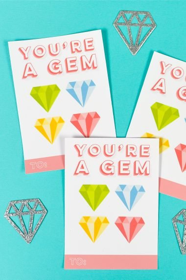 "Use the Print then Cut feature of your Cricut Explore or Maker to create this adorable ""you're a gem"" DIY sticker valentines! They are a great non-food valentine—and who doesn't love getting stickers? Includes free download!"