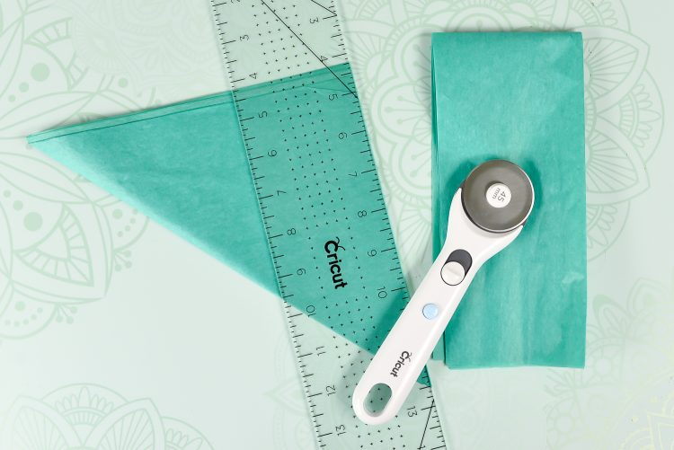 I use my rotary cutter, acrylic ruler, and self-healing mat for tissue paper projects