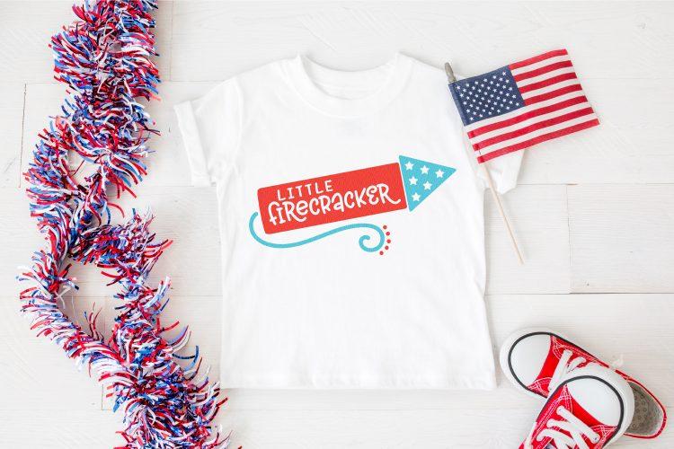 Little Firecracker mockup on a white t-shirt.