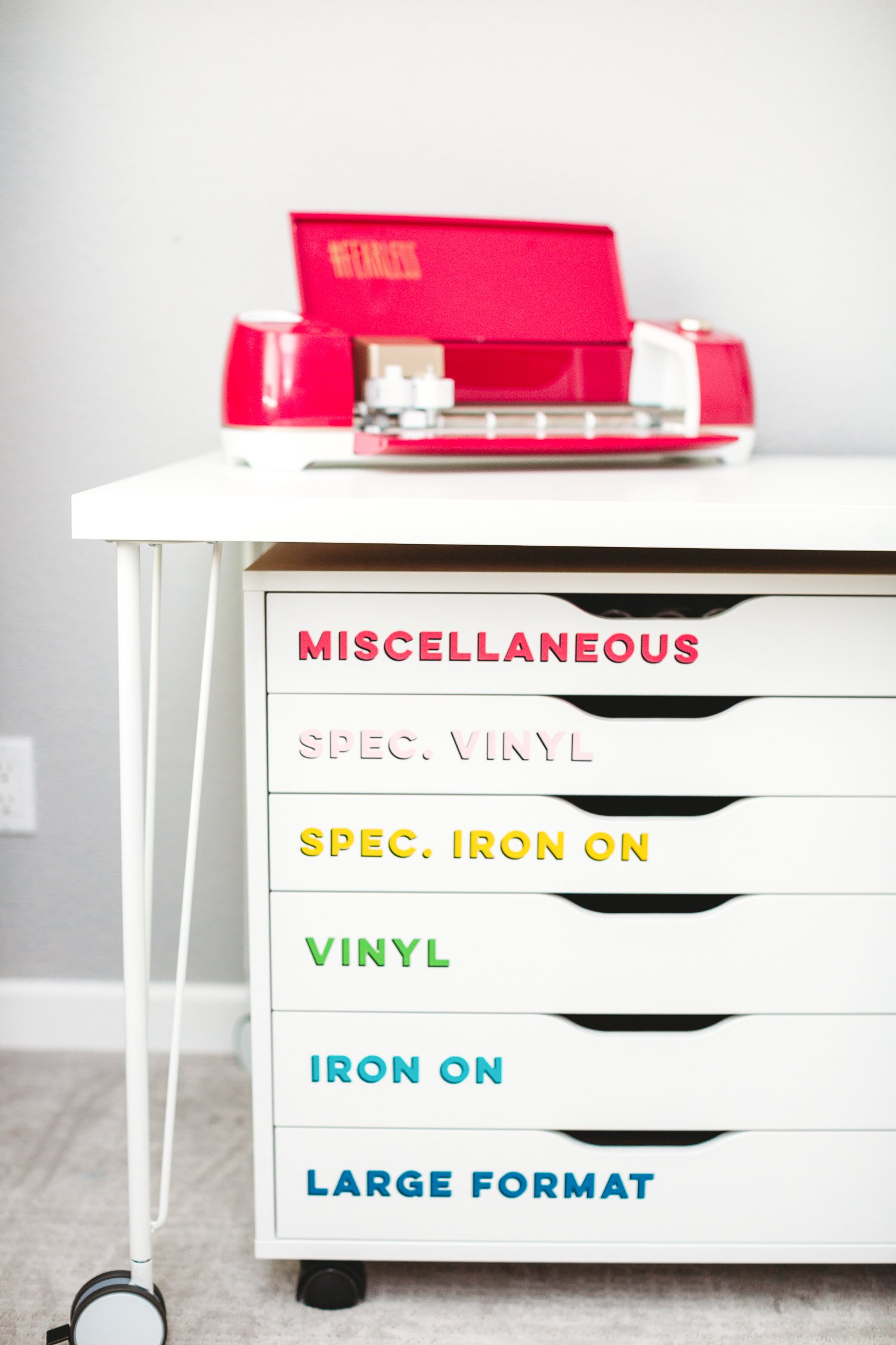 Organize your craft room with these bright modern craft room labels! Get more than 200 SVG labels to organize everything in your craft room, from adhesives to zippers. Cut on your Cricut or other cutting machine!