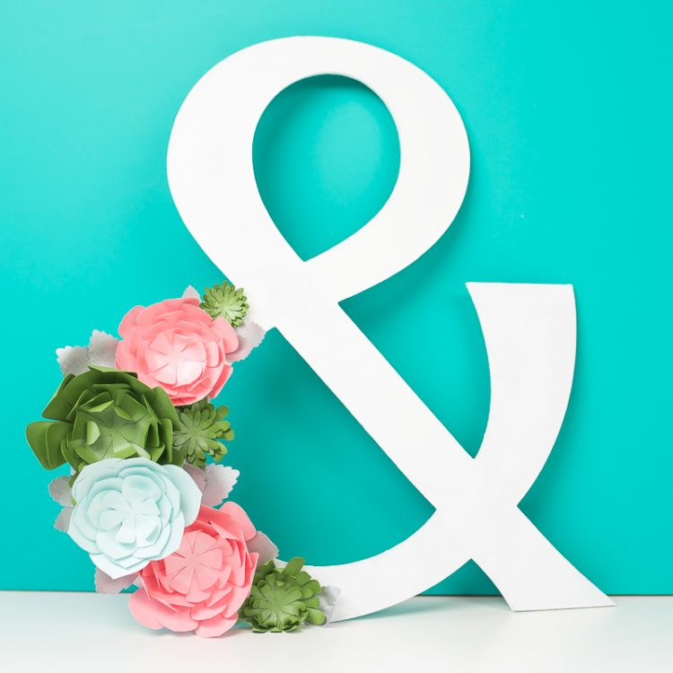 Make your very own paper succulents and dress up a giant ampersand, perfect for a master bedroom. Learn how to use your Cricut to make this colorful yet elegant piece.