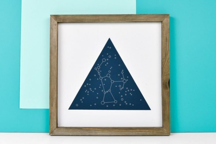 Framed celestial artwork made with a Cricut