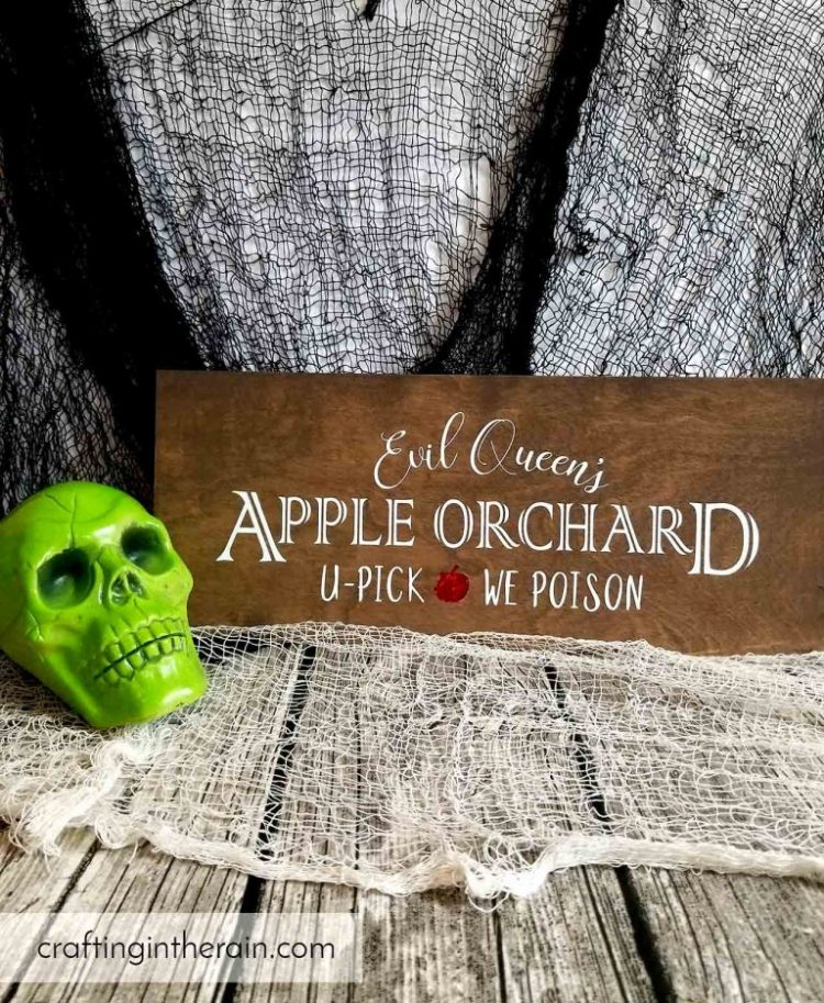 Your Halloween decorating wouldn't be complete without this Halloween SVG Queen's Apple Orchard Sign from craftingintherain.com.