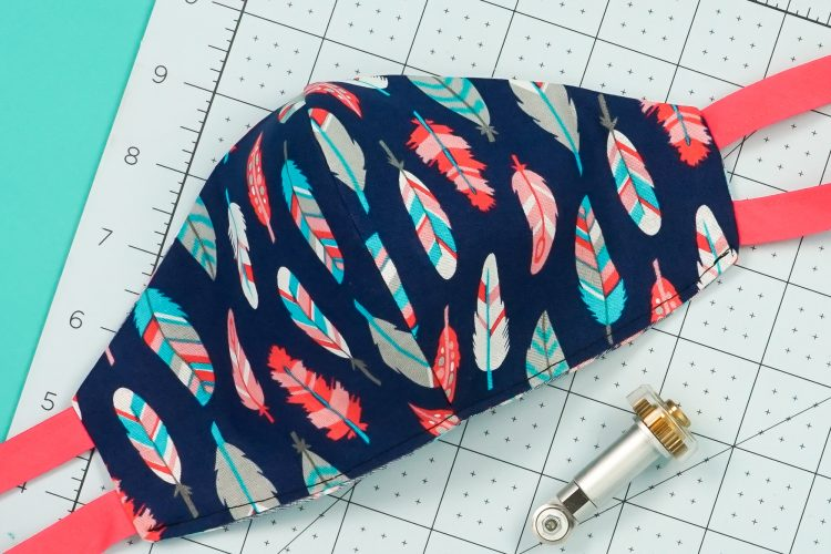 Make sewing a fitted mask pattern easier by cutting in your Cricut Maker! Get the free SVG to make this easy-to-sew fitted mask with ties or elastic.