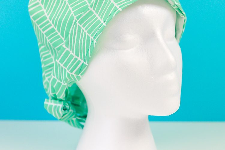 This Cricut scrub cap SVG pattern is easy to sew and includes an elastic piece to hold your hair! Just cut the fabric pattern pieces using your Cricut Maker and the rotary blade and assemble.