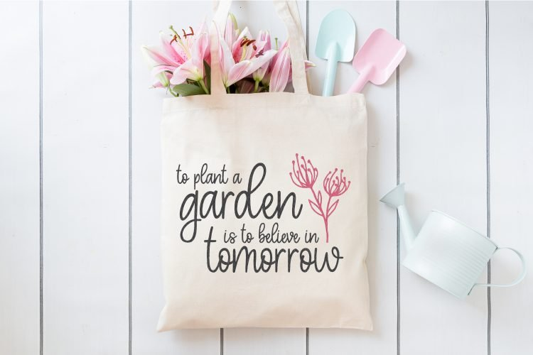 To Plant a Garden SVG on a gardening tote