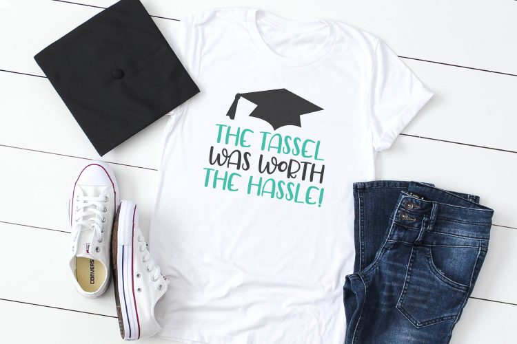 """The tassels was worth the hassle"" file on t-shirt with mortarboard."