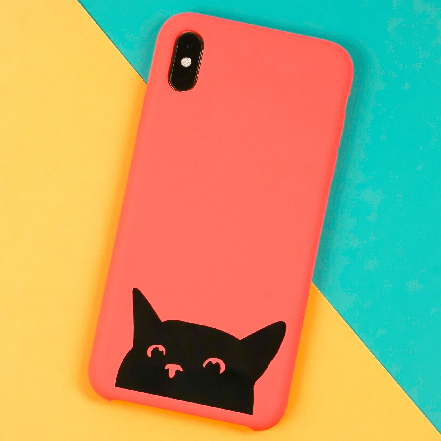 Cat phone case made with a Cricut on a yellow and teal background