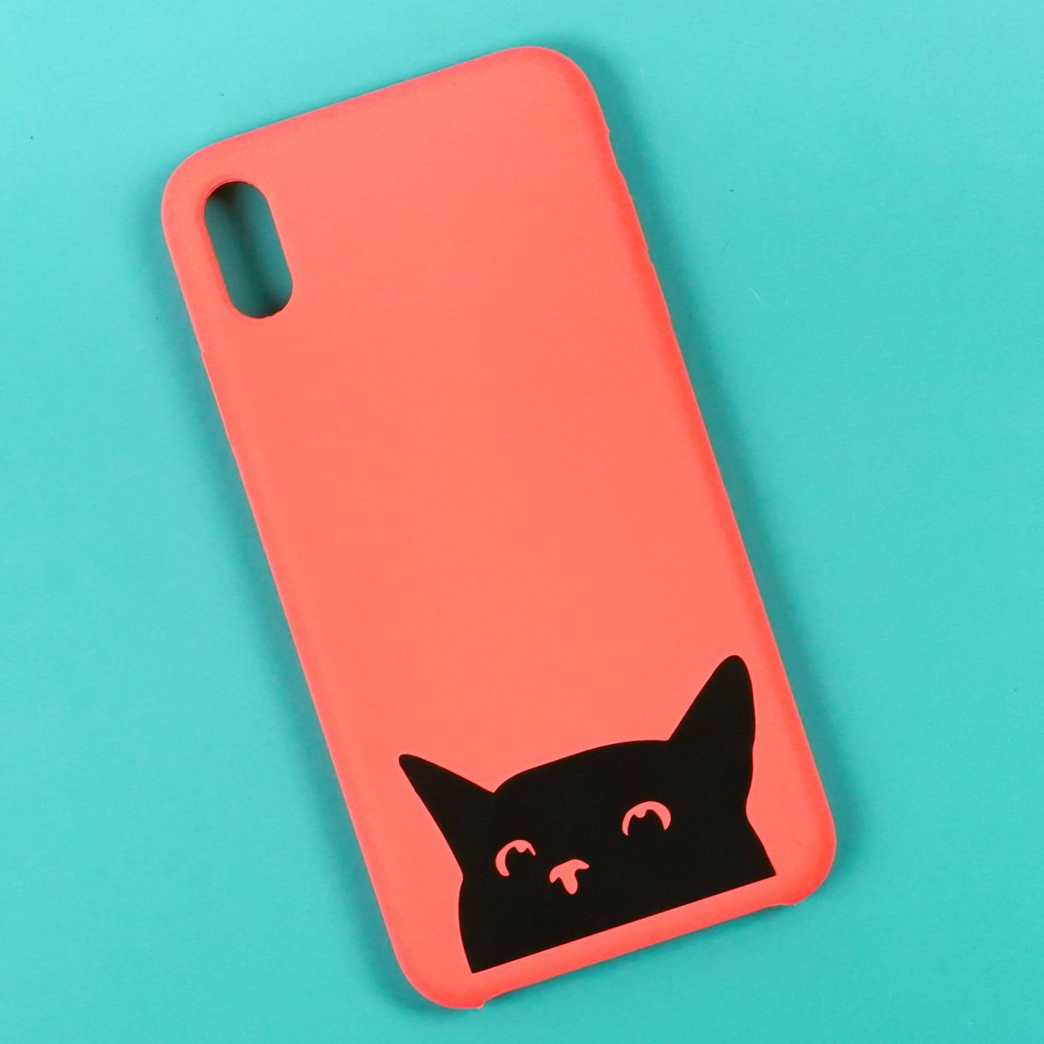Cat phone case made with a Cricut on a teal background