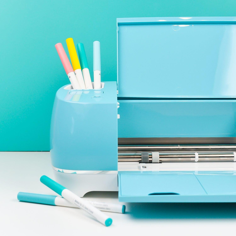 Blue Cricut Explore with pens