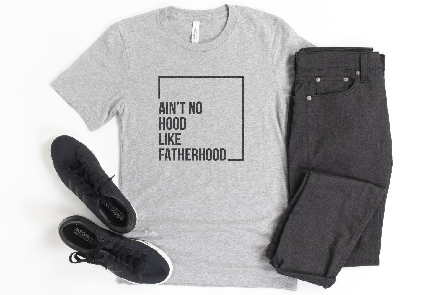 """Ain't No Hood Like Fatherhood"" SVG on a gray shirt with black pants."