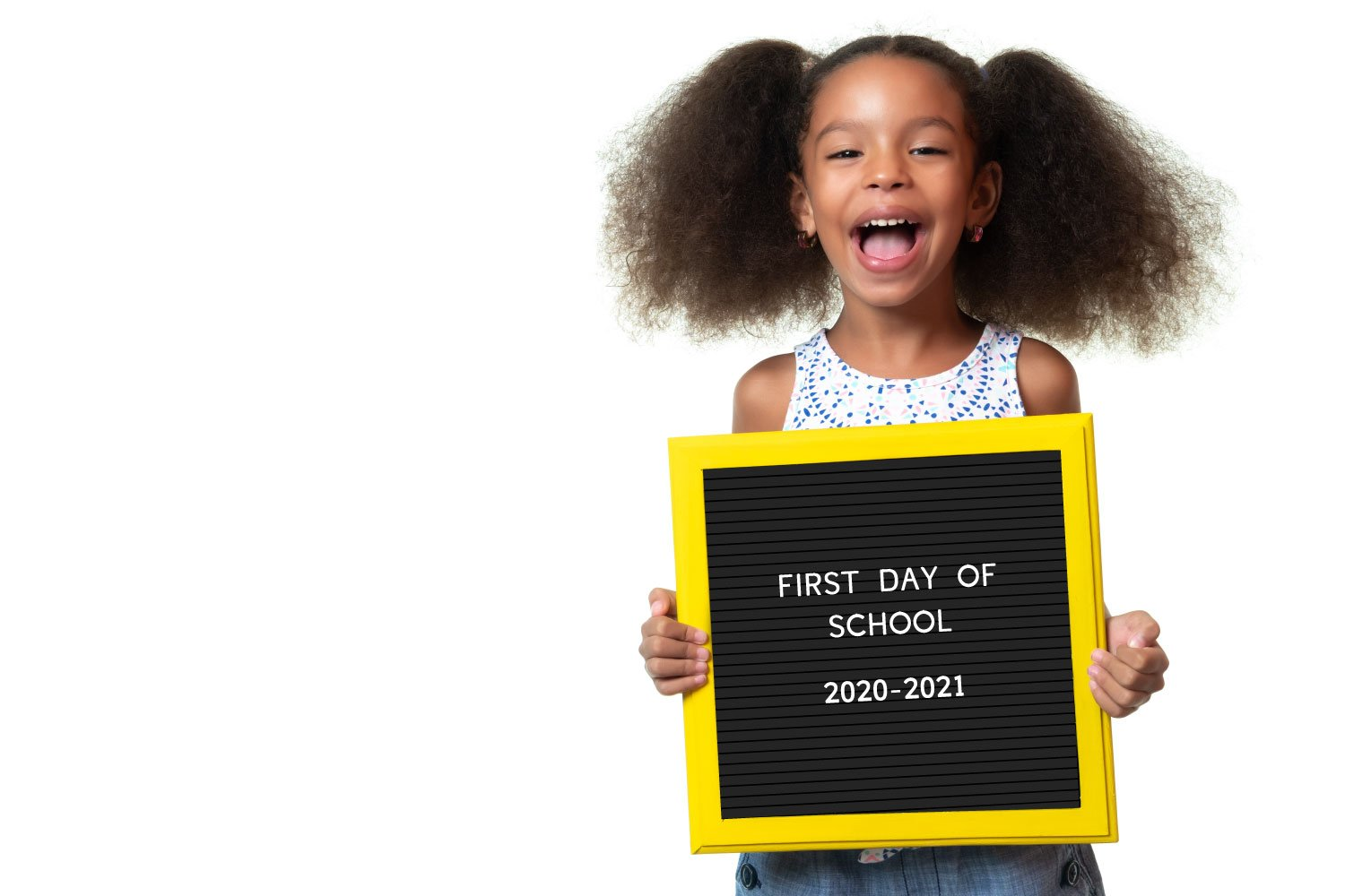 Young girl holding the printable letterboard school sign