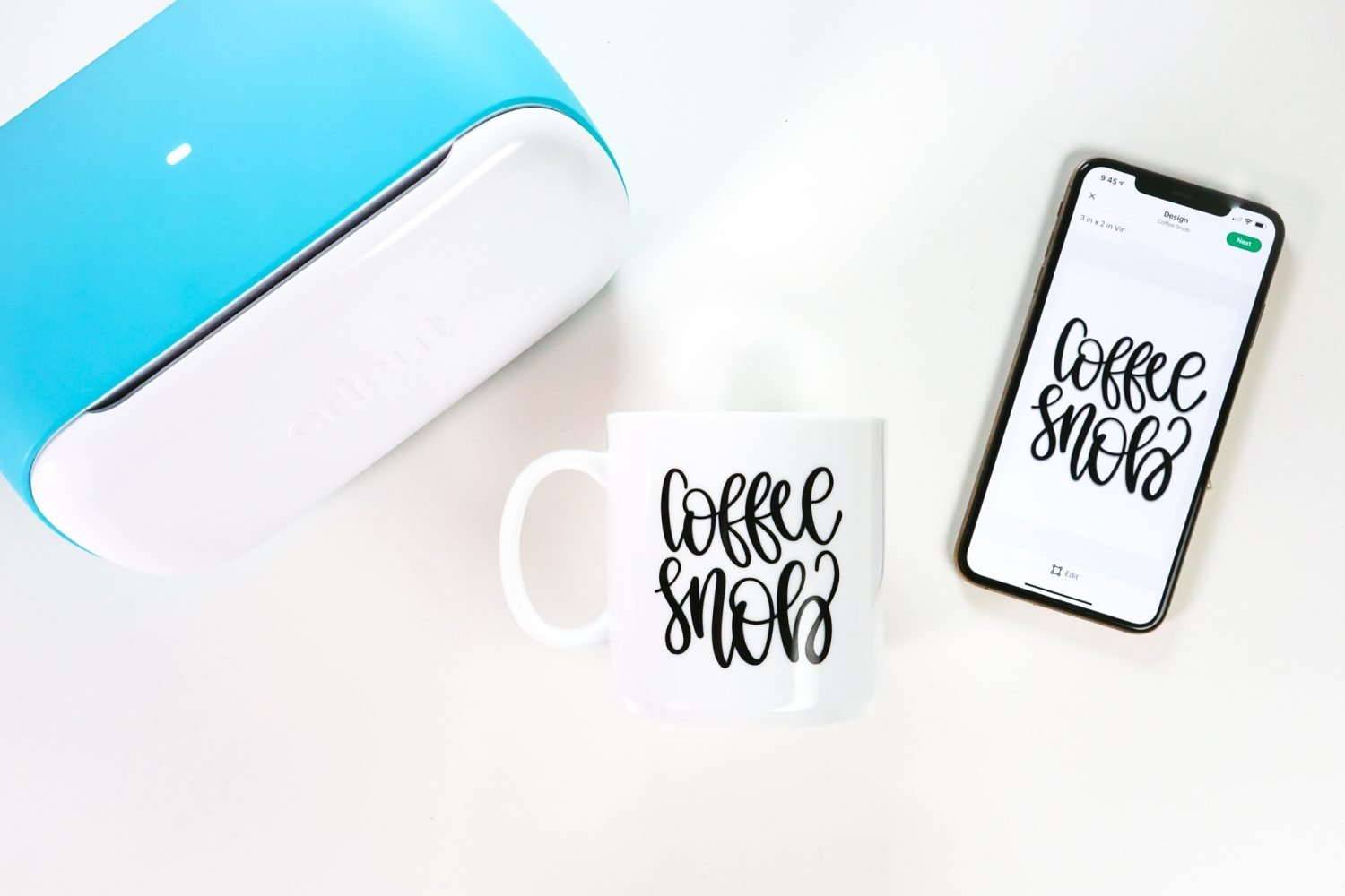 Cricut Joy with iPhone and Cricut Joy app with finished mug project