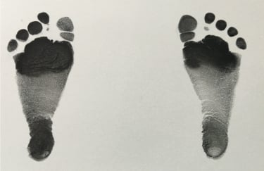 Phone image of newborn footprints