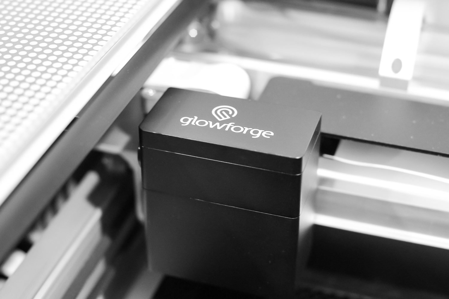 Glowforge laser head in machine.