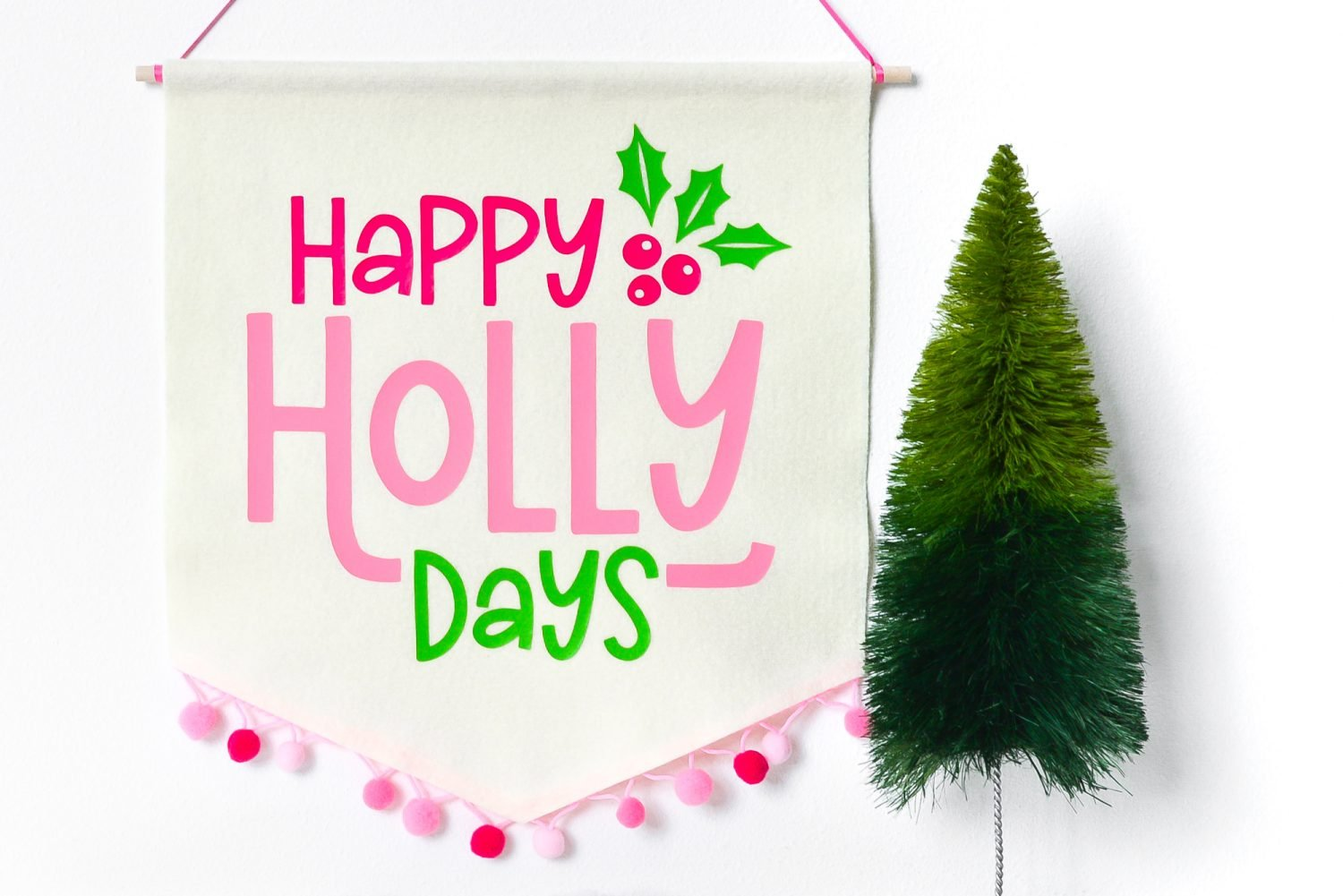 Deck your halls with this cute Happy Holly Days Christmas banner! Grab the free Happy Holly Days SVG file and make this banner with your Cricut or other cutting machine!