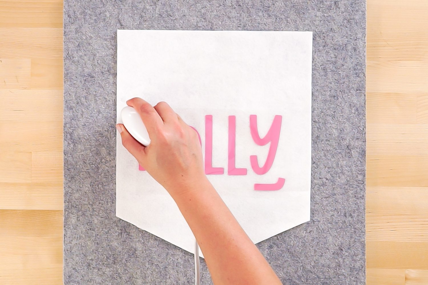 """Using the EasyPress Mini to apply the """"Holly"""" image."""
