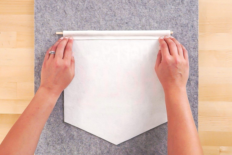Folding felt over the dowel and gluing.