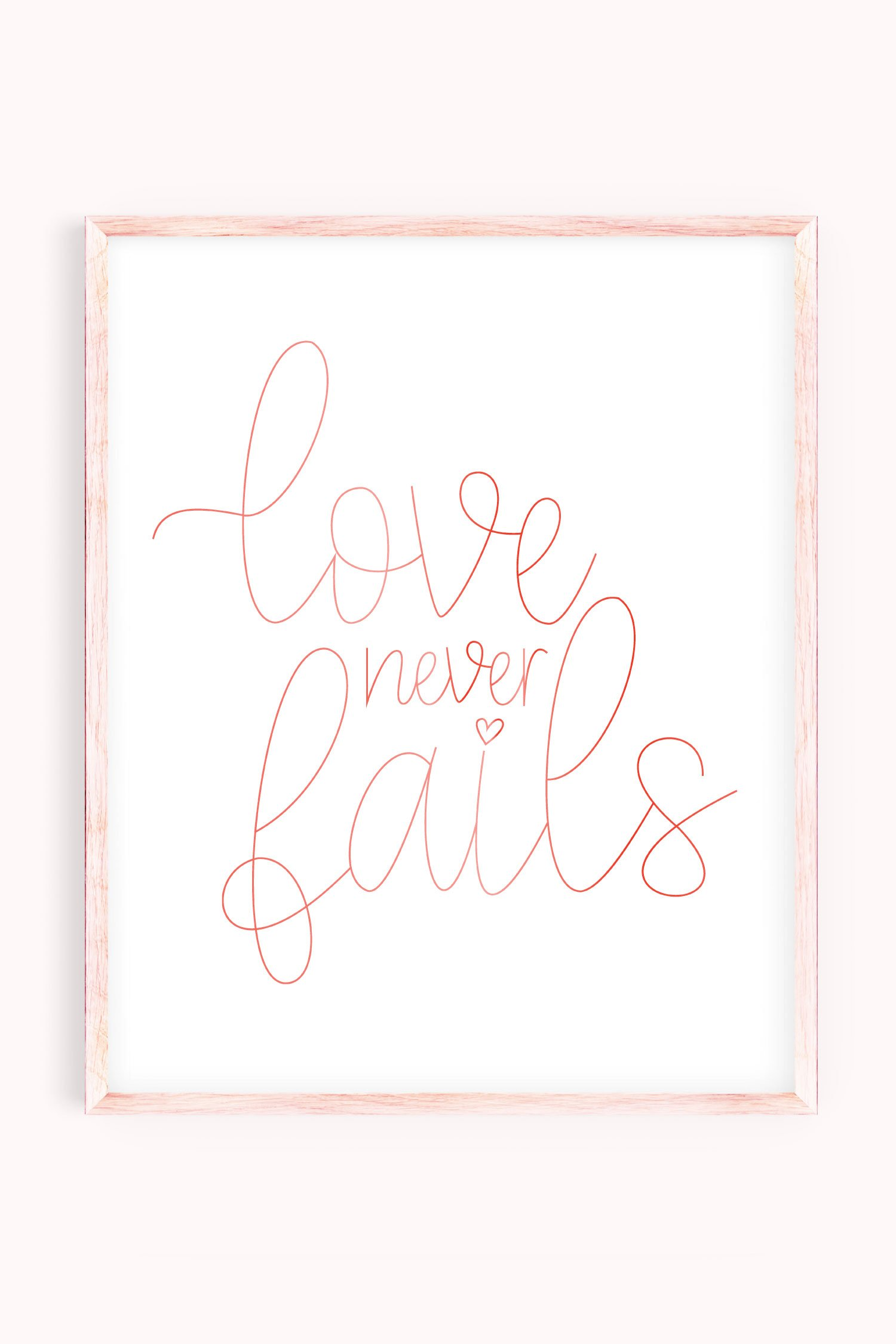 Love Never Fails artwork in pink frame