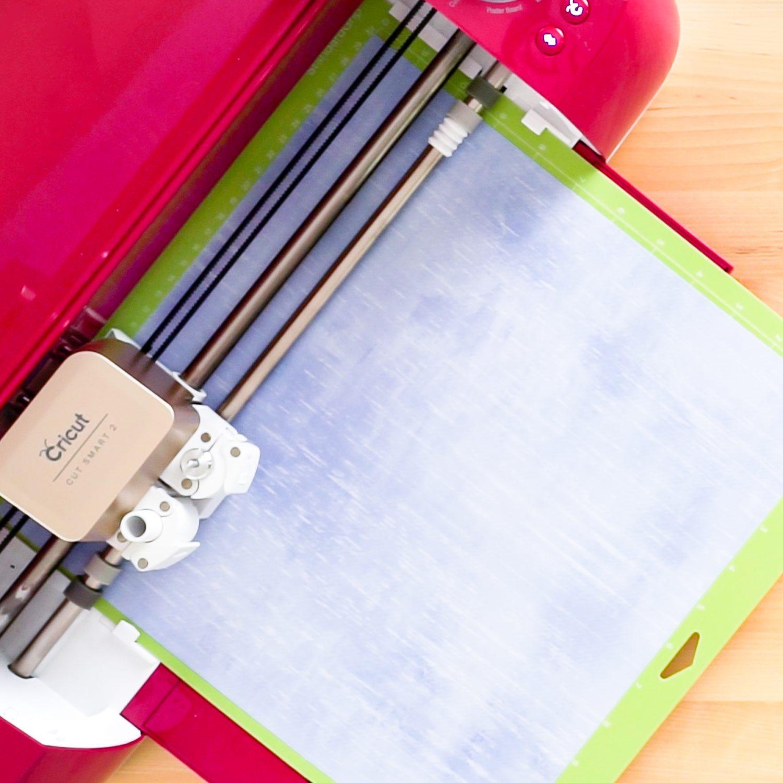 Cricut Explore machine cutting Infusible Ink transfer sheet.