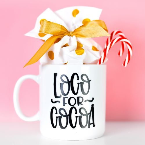 Final Loco for Cocoa mug staged with candy canes