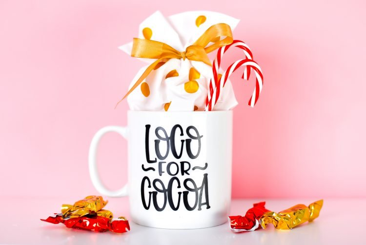 Final Loco for Cocoa mug with candy and candy canes.