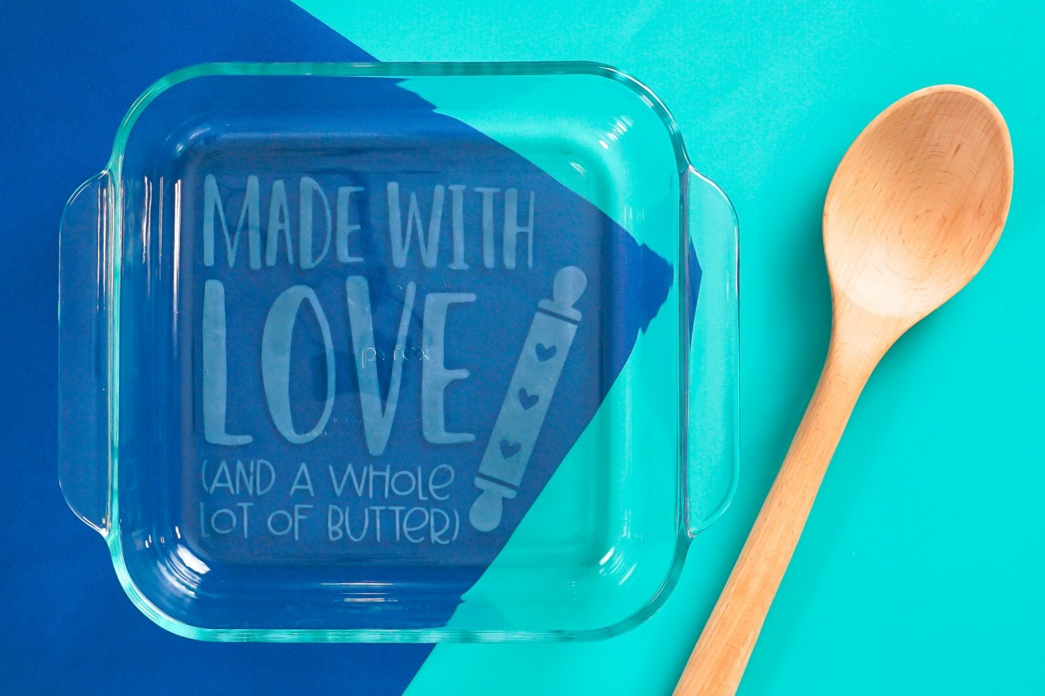 Finished baking dish on blue background with spoon.