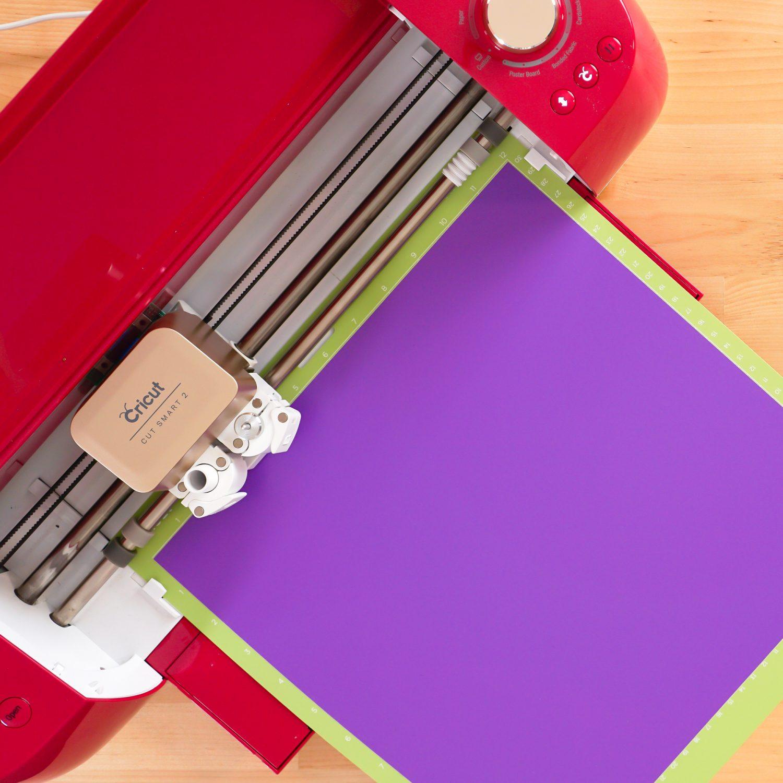 Cricut Explore cutting purple vinyl