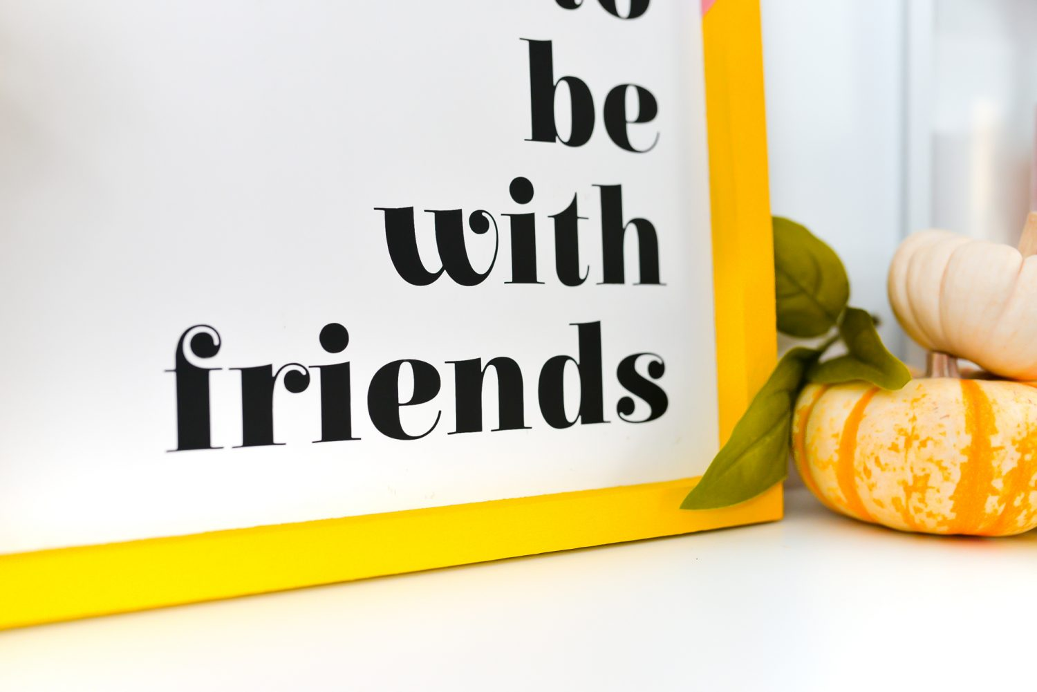 "Closeup of ""it's so good to be with friends"" sign"