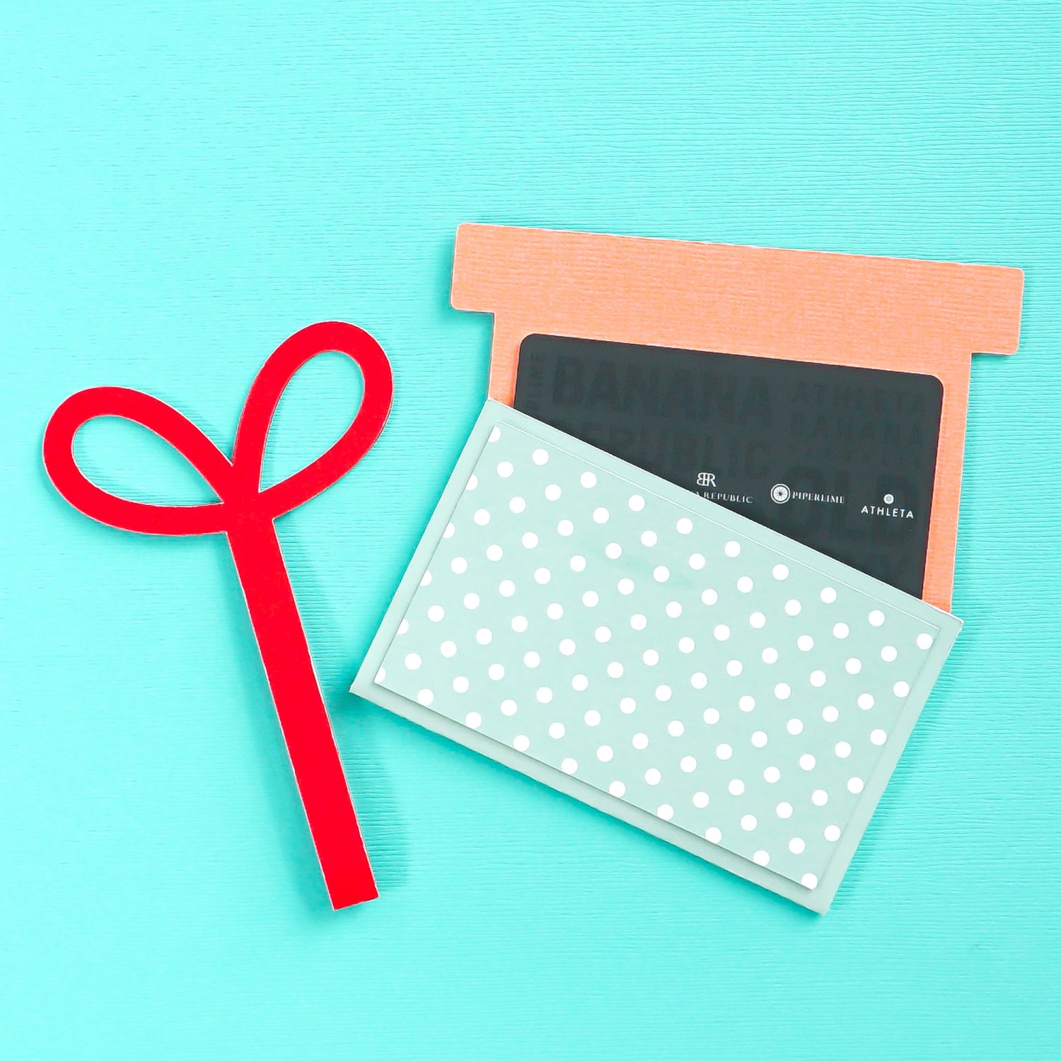 Finished gift card holder being opened on a blue background