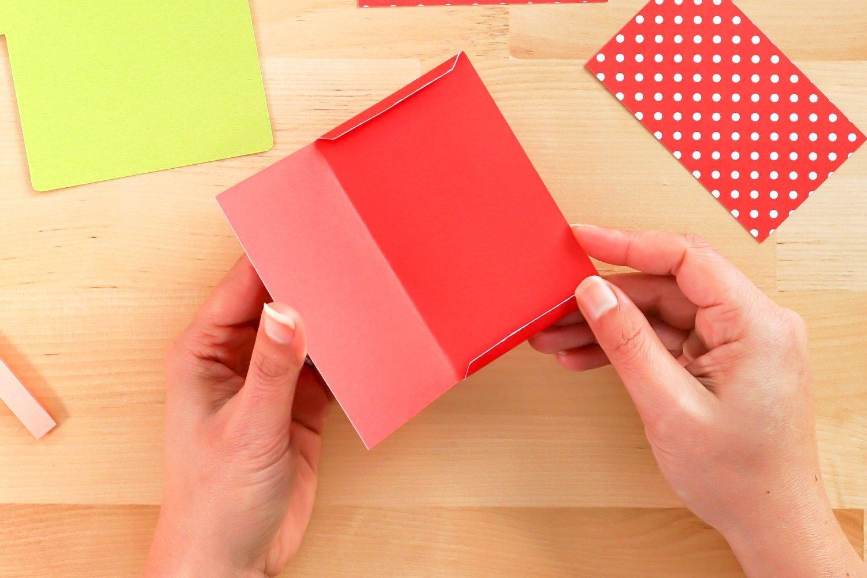Hands folding envelope