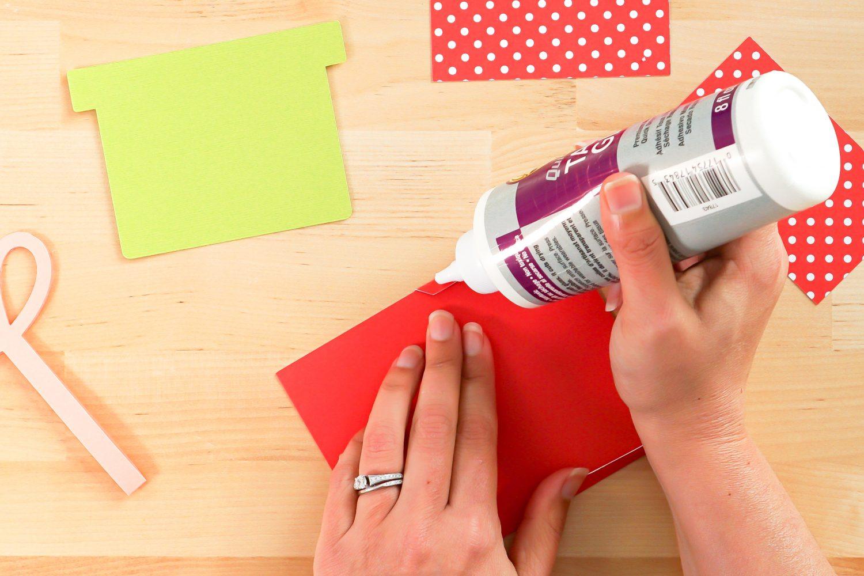 Hands gluing envelope