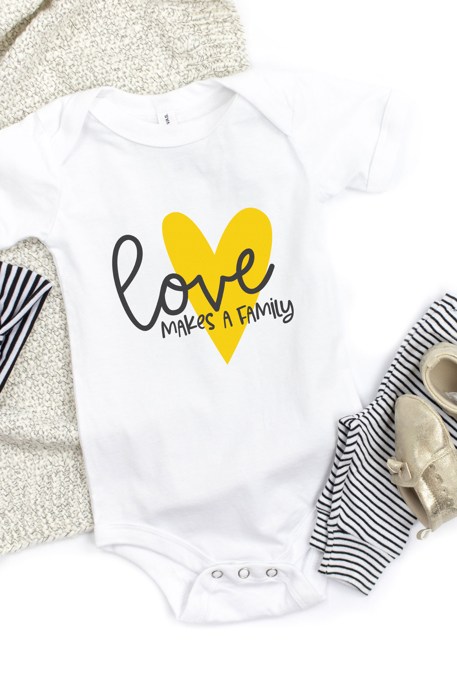 Love Makes a Family decal on a onesie