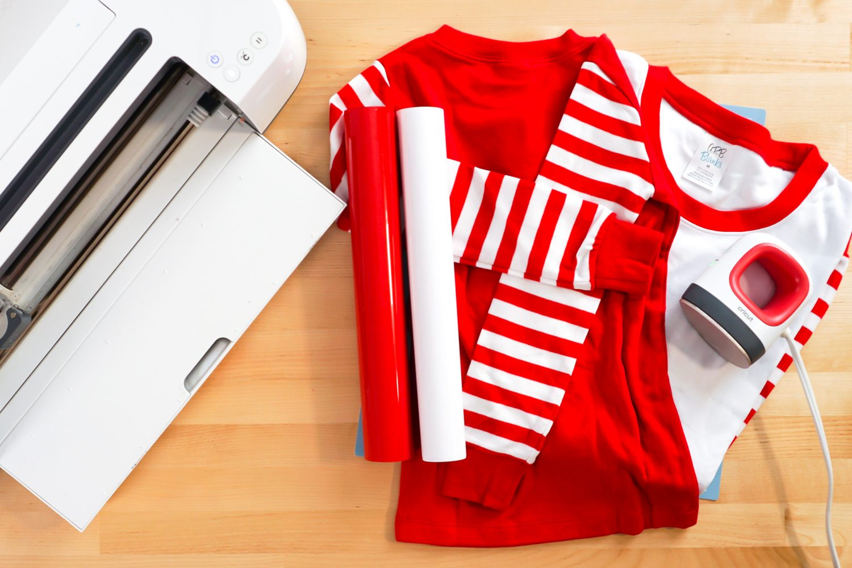 Supplies to make this project: Cricut, blank pajamas, iron on vinyl, and Cricut EasyPress Mini