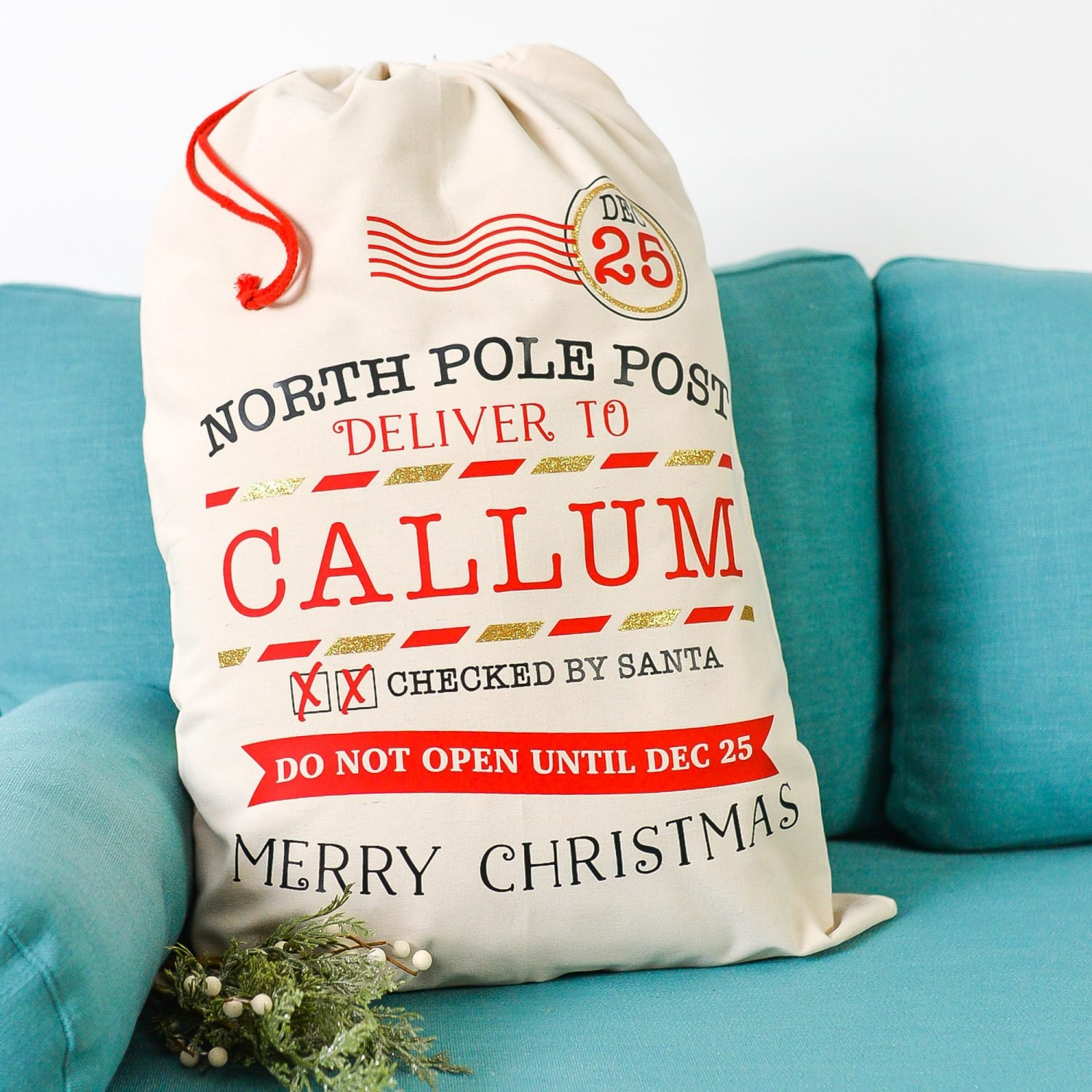 Final Christmas Santa Sack on Blue Couch