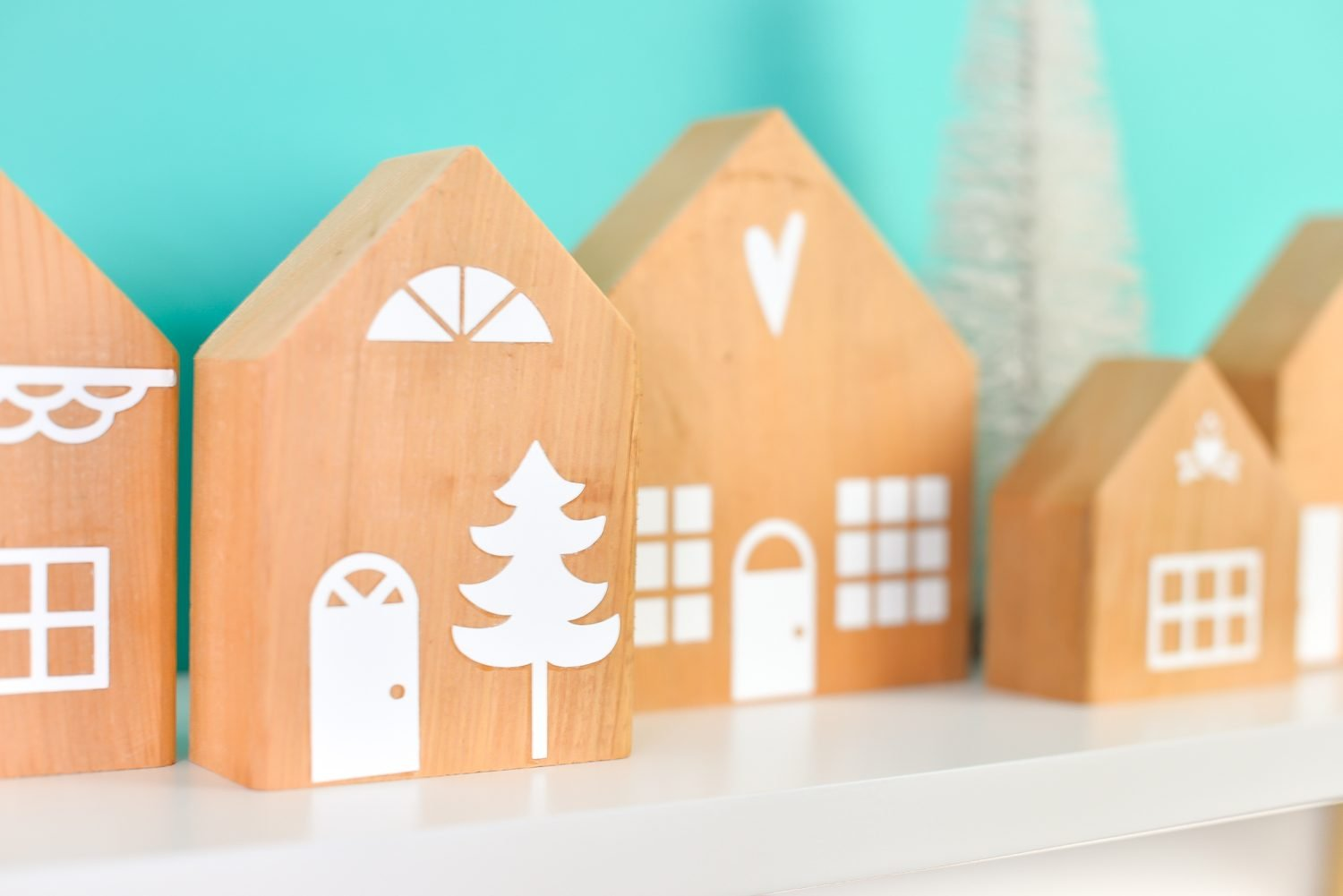 Angled view of the DIY Christmas Village on teal background