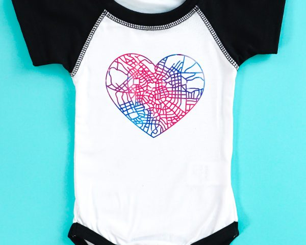 Cricut Infusible Ink bodysuit on teal background
